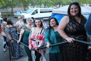 plus size model tishia lee waiting to walk in plus size fashion show with formal dress
